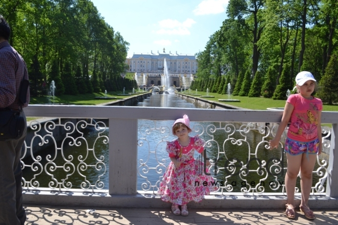 Peterhof: walking through time. St. Petersburg, Russia, July 13, 2017